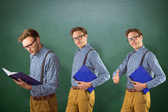 Composite image of nerd with notebook Royalty Free Stock Image