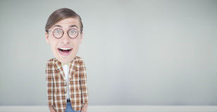 Composite image of nerd smiling Stock Image