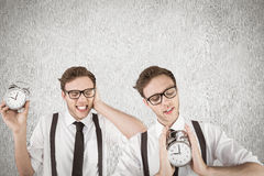 Composite image of nerdy businessman with alarm clock Stock Images