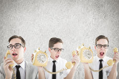 Composite image of nerdy businessman with phone Royalty Free Stock Photos