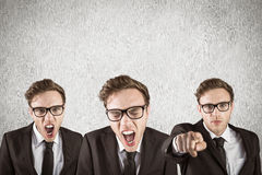 Composite image of nerdy businessman shouting Stock Photos