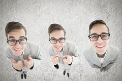 Composite image of nerdy businessman showing thumbs up Royalty Free Stock Photo