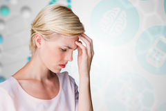 Composite image of nervous blonde woman Stock Images