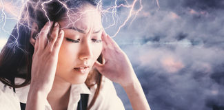 Composite image of nervous businesswoman holding her head Stock Photos
