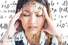 Composite image of nervous businesswoman holding her head Stock Photo