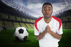 Composite image of nervous football fan in white looking ahead Royalty Free Stock Images