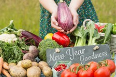 Composite image of new year goodness. New year goodness against vegetables at farmers market Royalty Free Stock Photo