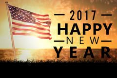 Composite image of new year graphic. New year graphic against composite image of american flag with firework royalty free stock photo