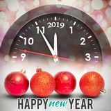 Composite image of new year graphic. New year graphic against glowing christmas background stock photos