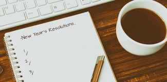 Composite image of new years resolution. New Years Resolution against notebook, keyboard, and coffee mug stock illustration