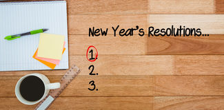 Composite image of new years resolution list. New years resolution list against business desk with smartphone and laptop Royalty Free Stock Image