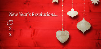 Composite image of new years resolution list. New years resolution list against christmas decorations over wood vector illustration