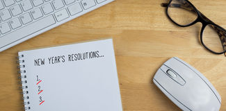 Composite image of new years resolution list. New years resolution list against overhead of notebook and glasses stock illustration