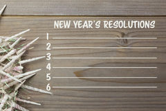 Composite image of new years resolution list. Against wooden wall royalty free illustration
