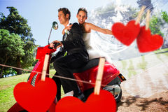 Composite image of newlywed couple enjoying scooter ride Stock Photography