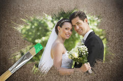 Composite image of newlyweds smiling at camera Royalty Free Stock Image