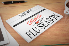 Composite image of newspaper with flu headline Stock Photos