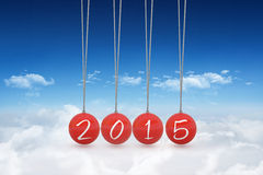 Composite image of 2015 newtons cradle Royalty Free Stock Photo