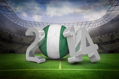 Composite image of nigeria world cup 2014. Nigeria world cup 2014 against large football stadium with lights Royalty Free Stock Images