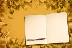 Composite image of notebook and pen Stock Image