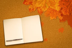 Composite image of notebook and pen Royalty Free Stock Photos
