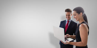 Composite Image Of Business Colleagues Using Laptop Royalty Free Stock Photo