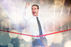 Free Composite Image Of Businessman Crossing The Finish Line While Clenching Fist Stock Image - 54356421
