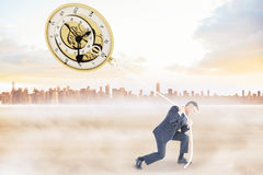 Composite Image Of Classy Businessman Pulling A Rope Stock Photography