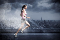 Composite Image Of Profile View Of Sportswoman Running On A White Background Stock Photos