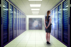 Composite Image Of Redhead Businesswoman With Hands Behind Back Stock Images