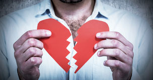 Free Composite Image Of Sad Man Holding Heart Halves Royalty Free Stock Image - 66209216