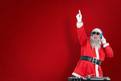 Free Composite Image Of Santa Claus Playing Dj With Raised Hand Stock Photos - 81105133
