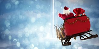 Composite Image Of Santa Claus Riding On Sled With Gift Box Royalty Free Stock Photos