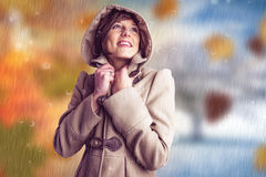 Free Composite Image Of Smiling Beautiful Woman In Winter Coat Looking Up Stock Photos - 63282963
