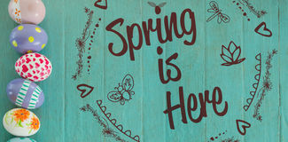 Composite Image Of Spring Is Here Logo Against Background Royalty Free Stock Photos