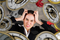 Free Composite Image Of Stressed Businesswoman With Hands On Her Head Stock Photo - 55497980