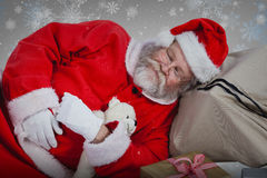 Free Composite Image Of Tired Santa Claus Sleeping Beside Christmas Presents Royalty Free Stock Photos - 81111058