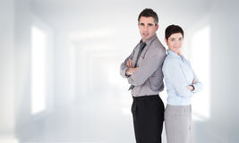 Composite image of office workers standing up back-to-back Stock Photos