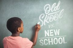 Composite image of old school vs new school. Old school vs new school against boy writing with chalk on greenboard in school royalty free stock images