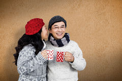 Composite image of older asian couple having hot drinks Royalty Free Stock Photos