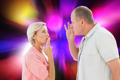 Composite image of older couple holding hands to mouth for silence Royalty Free Stock Photos