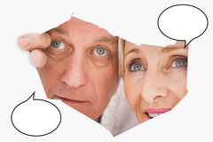 Composite image of older couple looking through rip Royalty Free Stock Photos