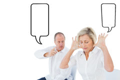 Composite image of older couple sitting in chairs arguing Stock Images