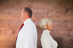 Composite image of older couple standing not facing each other Royalty Free Stock Photos