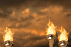 Composite image of the olympic fire. The olympic fire against blue and orange sky with clouds Royalty Free Stock Image
