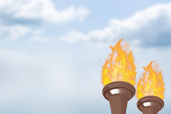 Composite image of the olympic fire. The olympic fire against blue sky Royalty Free Stock Image