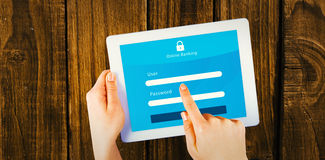 Composite image of online banking. Online banking against hands using tablet pc stock image