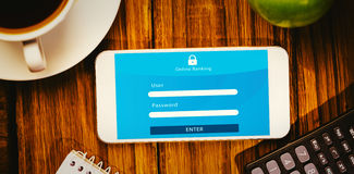 Composite image of online banking. Online banking against smartphone on desk royalty free stock images