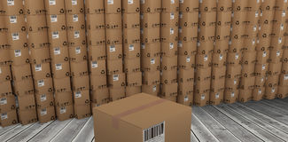Composite image of packed brown cardboard box. Packed brown cardboard box against dark room Stock Photography