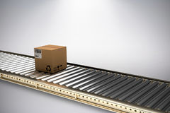 Composite image of packed cardboard box on conveyor belt Royalty Free Stock Images
